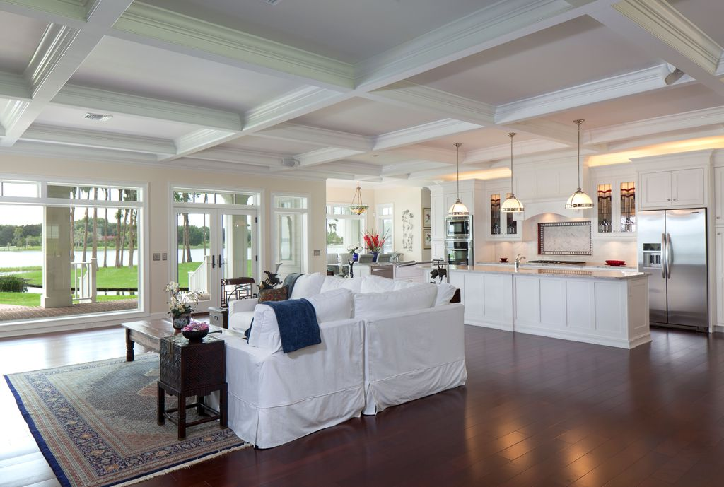 Traditional Great Room with Pendant light, Hardwood floors, Paint 1, French doors, Surya adana navy blue/red area rug