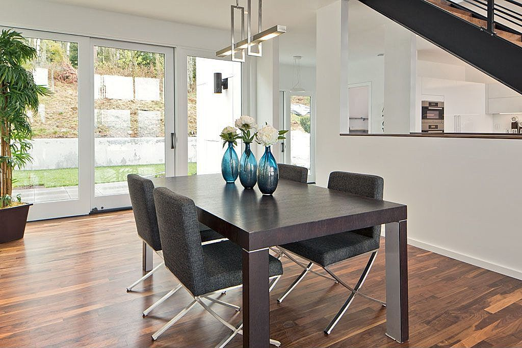 Dining Room with Hardwood floors, specialty window, Pendant light, Standard height, French doors, Columns
