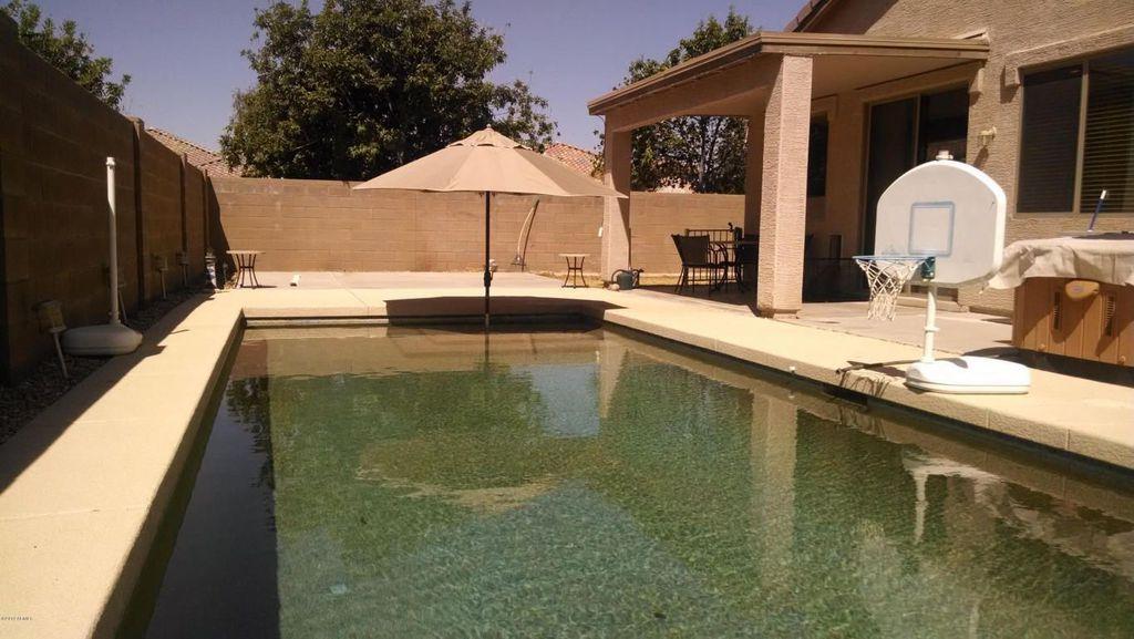 Mediterranean Swimming Pool with exterior tile floors, Stone/brick fence, exterior concrete tile floors, Fence, Casement