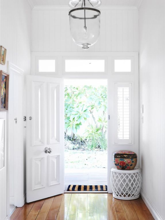 Traditional Entryway with Crown molding, Hardwood floors, flush light, Transom window, specialty door, Standard height