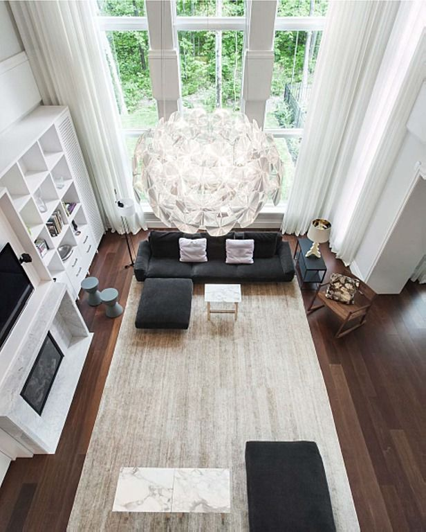 Modern Living Room with Fireplace, Cathedral ceiling, Chandelier, picture window, Built-in bookshelf, other fireplace