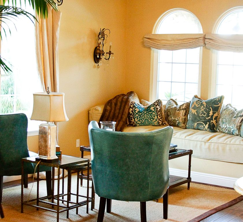 Mediterranean Living Room with Hardwood floors, Arched window, Wall sconce, Standard height, Paint 1, Casement