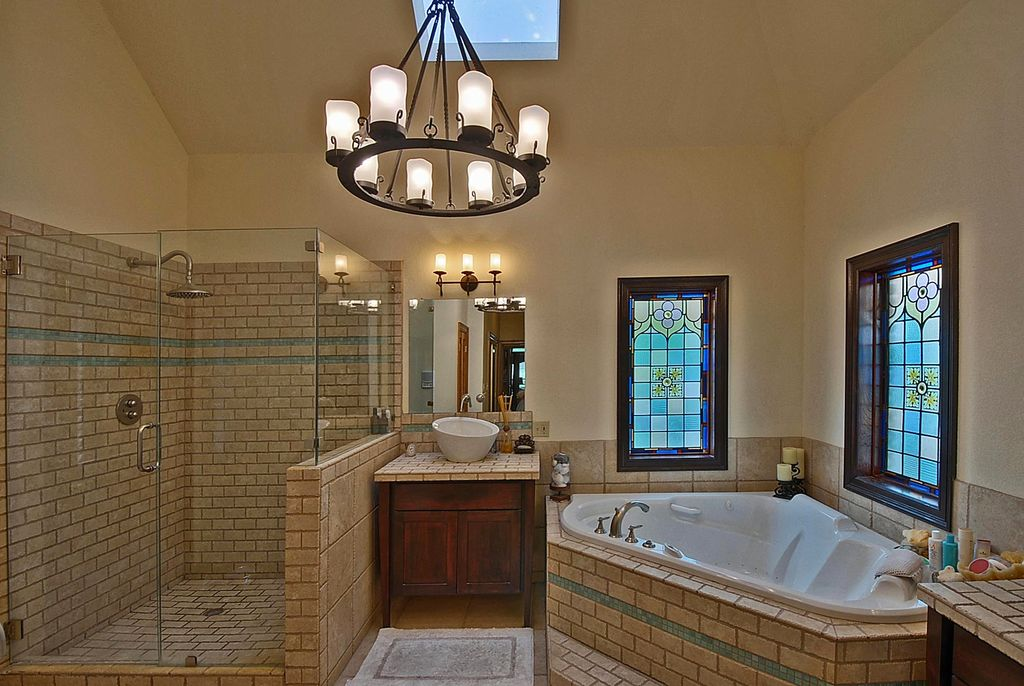Traditional Master Bathroom with Limestone tile counters, Stone Tile, Master bathroom, Vessel sink, Chandelier, Rain shower