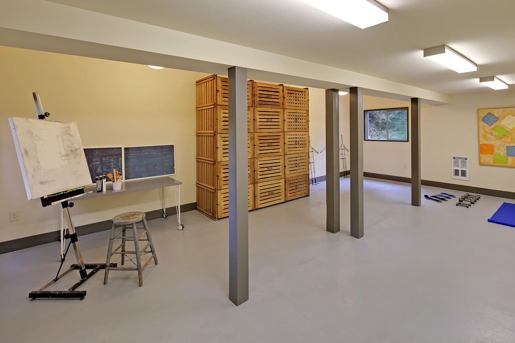 Contemporary Playroom with Art desk, Exposed beam, flush light, Columns, Concrete floors, Standard height, picture window