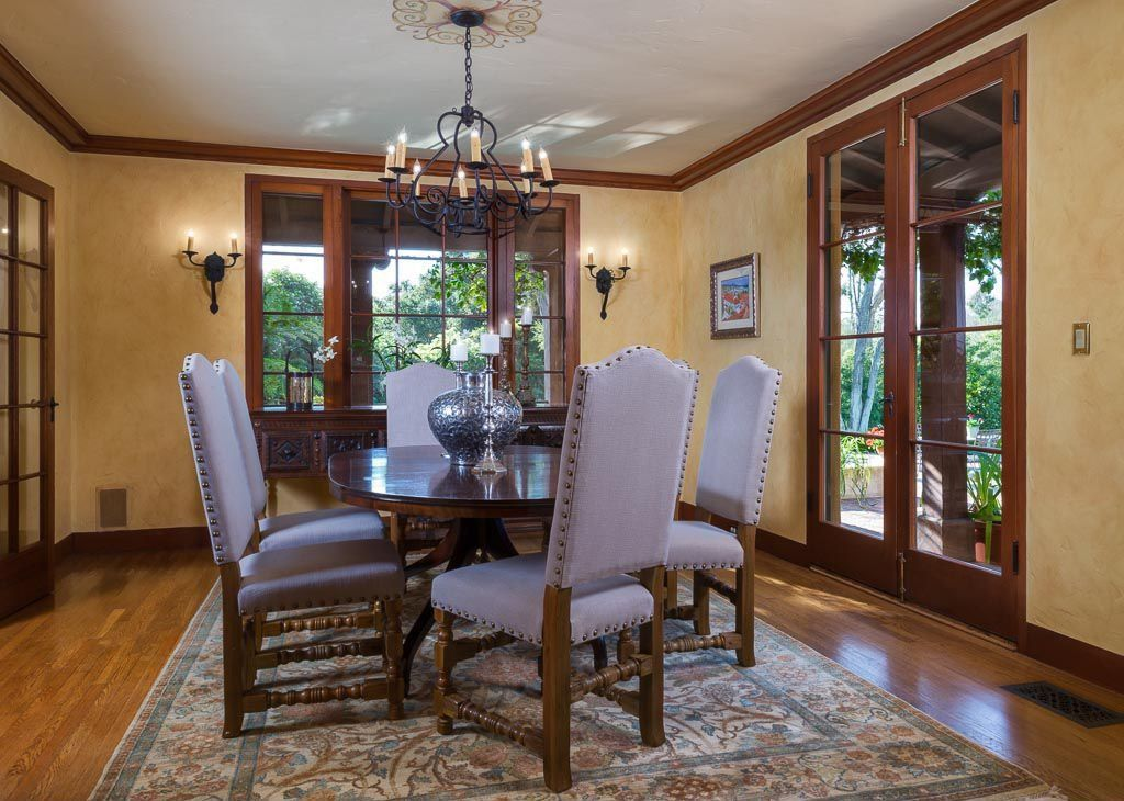 Craftsman Dining Room with Hardwood floors, Standard height, French doors, Crown molding, Chandelier, Wall sconce, Casement