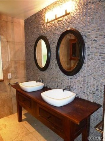 Eclectic Master Bathroom with Threshold Deep Round Mirror - Black, Cobblestone pebble tile, Kohler - escale vessel sink