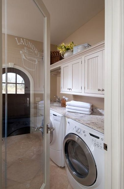 Cottage Laundry Room with Meta marble & granite slab in florata white, limestone floors, French doors, Built-in bookshelf