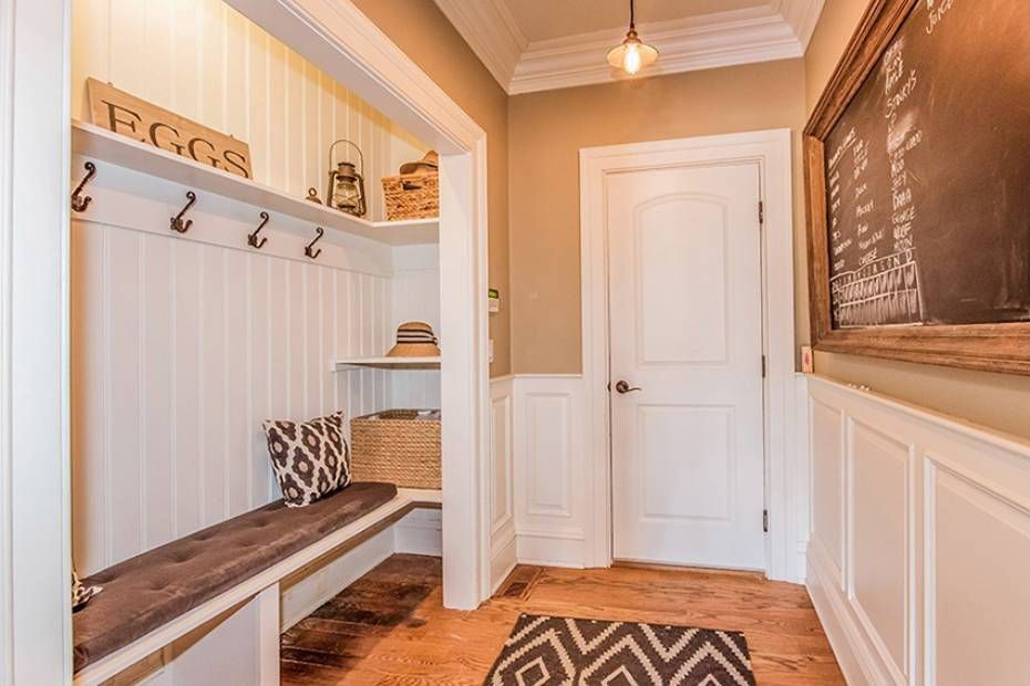 Traditional Mud Room with Hardwood floors, Wainscotting, Crown molding, Standard height, Built-in bookshelf, specialty door