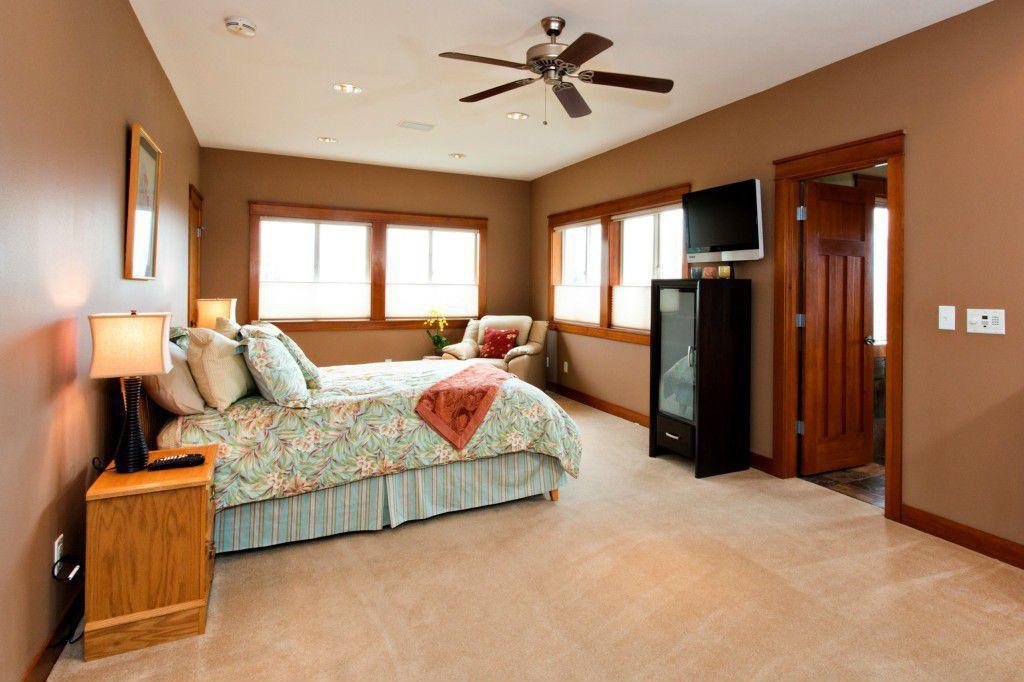 Master Bedroom with Casement, specialty door, Carpet, Standard height, Ceiling fan, can lights