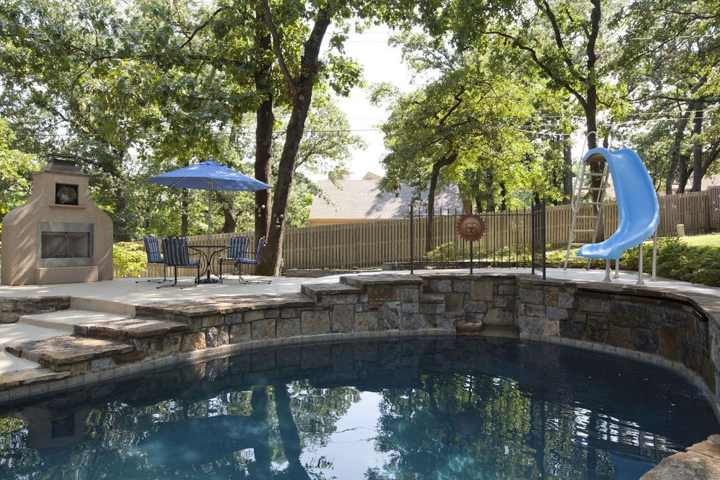 Rustic Swimming Pool with Fence, outdoor pizza oven, Pathway, Other Pool Type, exterior stone floors