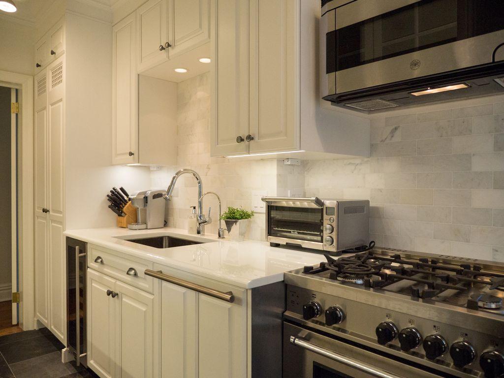Contemporary Kitchen with Micro Hood, flush light, Crown molding, dishwasher, Raised panel, slate tile floors, Subway Tile