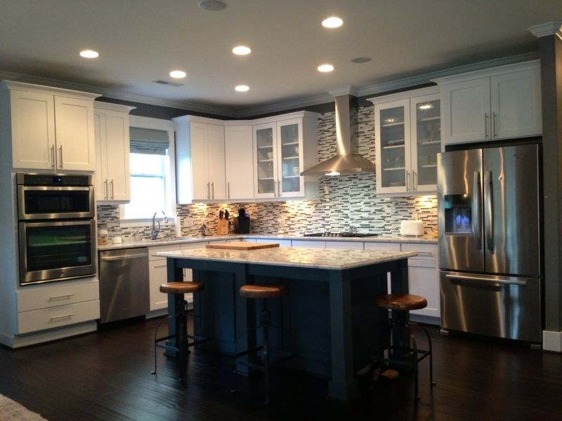 Contemporary Kitchen with Crown molding, Multiple Refrigerators, Flat panel cabinets, Undermount sink, Wall Hood, wall oven