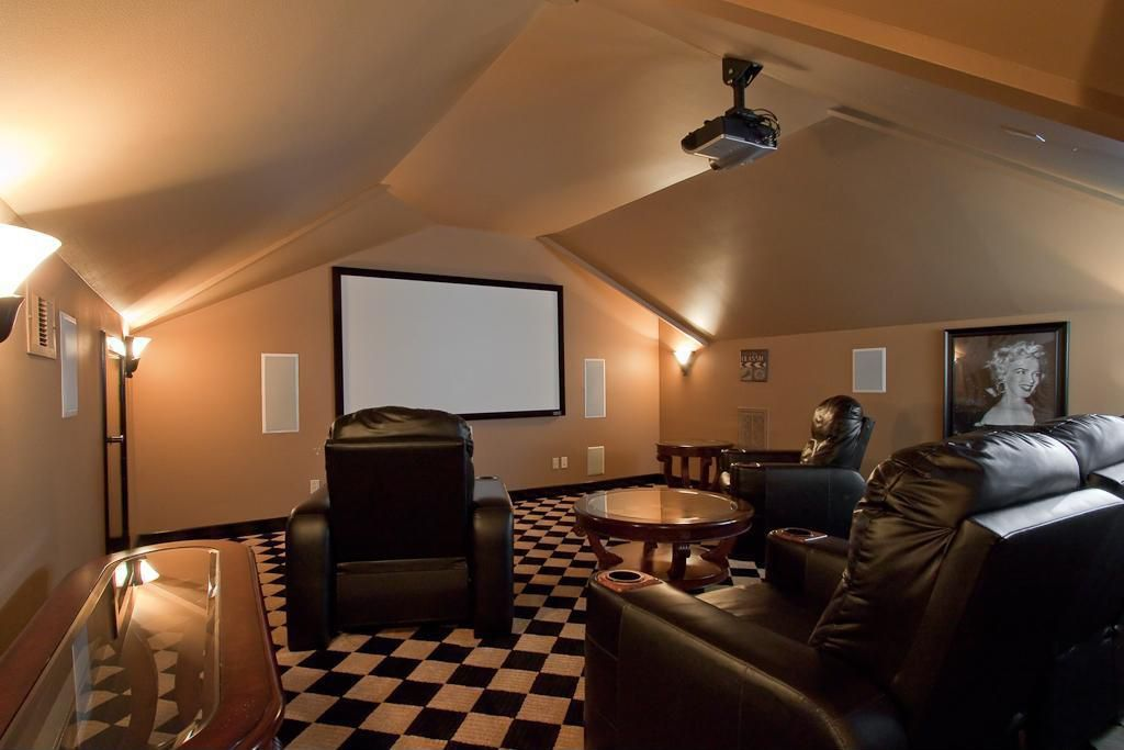 Eclectic Home Theater with Wall sconce, Cathedral ceiling, Glass panel door, Carpet