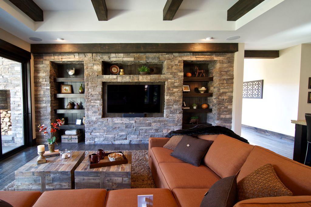 Craftsman Living Room with Hardwood floors, Standard height, Exposed beam, sliding glass door, can lights, Built-in bookshelf