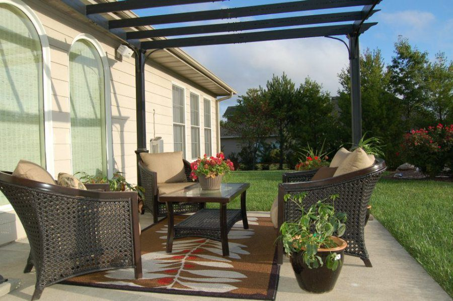 Traditional Patio with Arched window, Fence, exterior tile floors, Trellis, double-hung window, exterior concrete tile floors