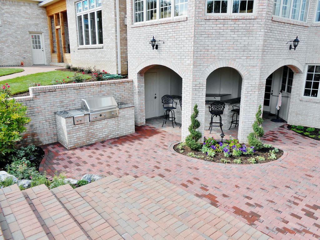 Traditional Patio with Raised beds, Casement, exterior brick floors, Pathway, Outdoor kitchen, French doors