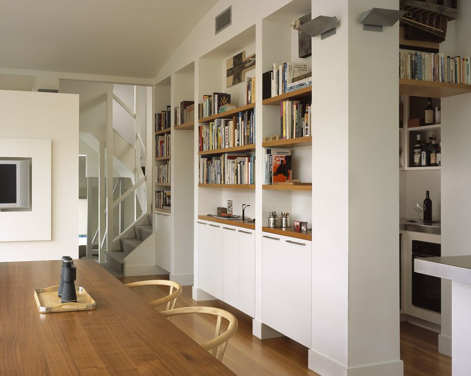 Contemporary Hallway with Built-in bookshelf, Hardwood floors, Standard height, Wall sconce