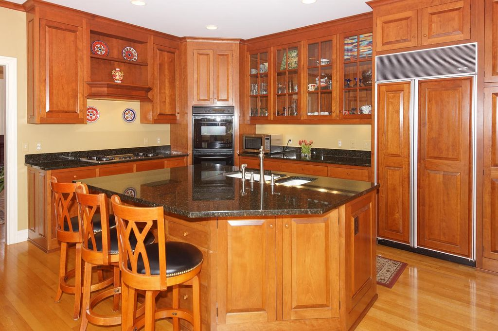 Traditional Kitchen with Simple Granite, Glass panel, L-shaped, Kitchen island, Breakfast bar, electric cooktop, Custom hood