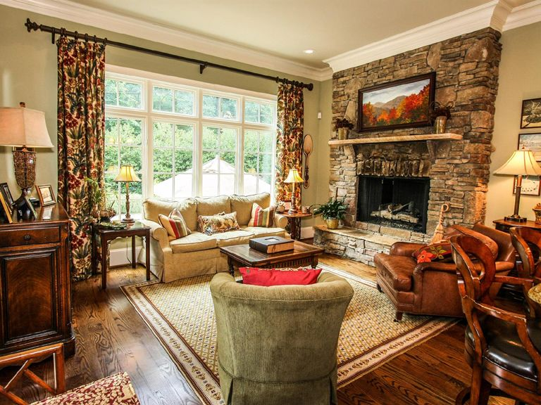 Traditional Living Room with can lights, Casement, Hardwood floors, stone fireplace, Crown molding, Fireplace