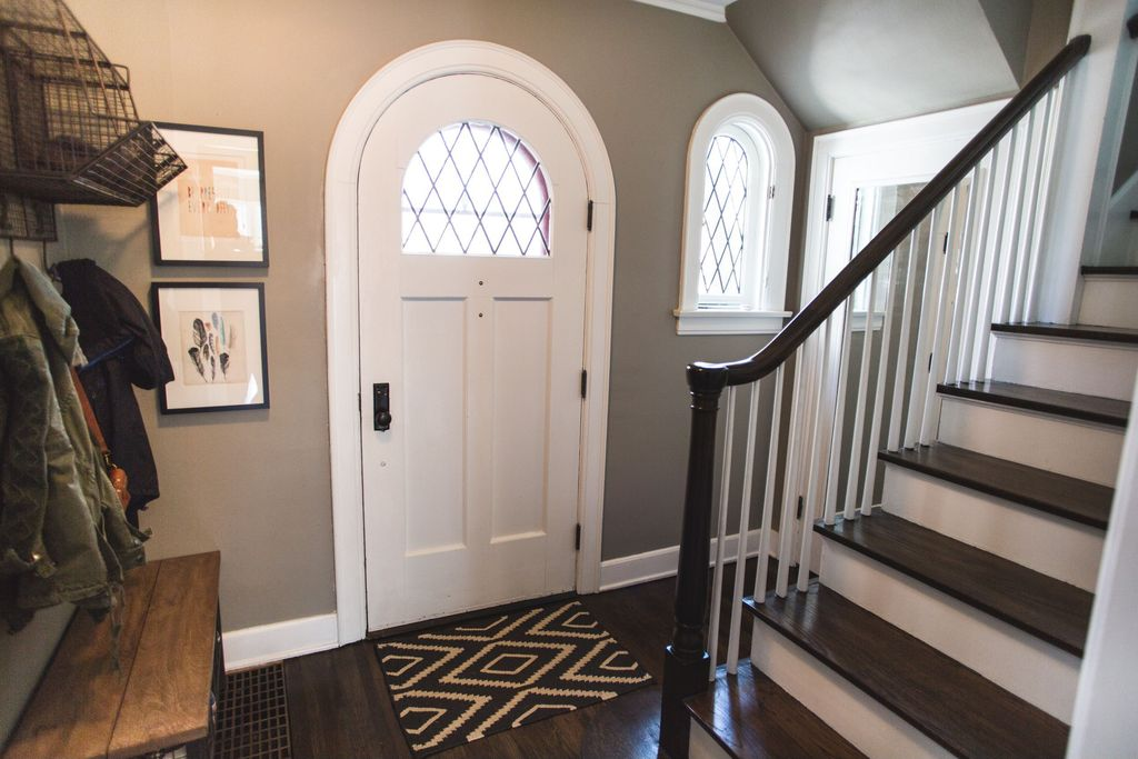 Traditional Entryway with Arched window, Standard height, Hardwood floors, Glass panel door, Paint, Crown molding