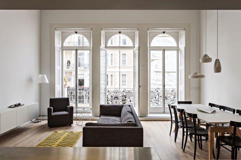 Modern Great Room with High ceiling, Pendant light, Transom window, Built-in bookshelf, French doors, Hardwood floors