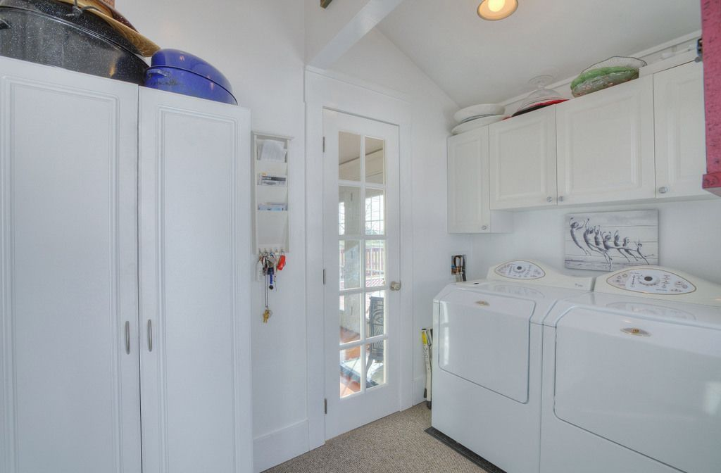 Traditional Laundry Room with can lights, laundry sink, Built-in bookshelf, Exposed beam, Standard height, French doors