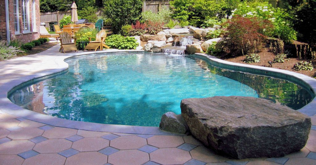Swimming Pool with Outdoor kitchen, Fence, Casement, exterior tile floors, Other Pool Type, exterior interlocking pavers