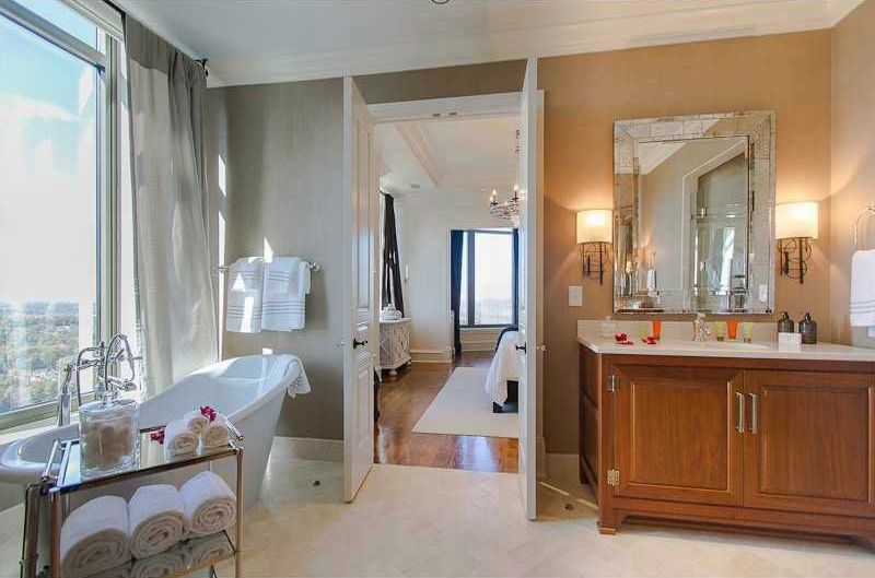 Traditional Master Bathroom with Freestanding, limestone tile floors, Crown molding, Corian counters, Undermount sink, Flush