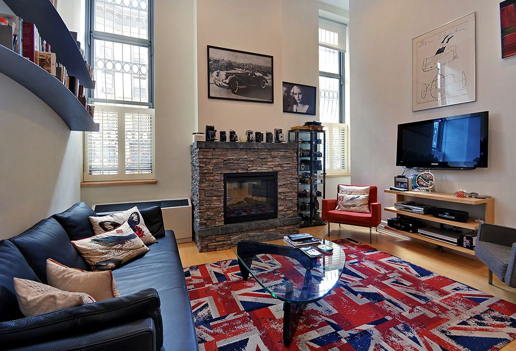 Modern Living Room with High ceiling, Hardwood floors, Casement, Built-in bookshelf, double-hung window, stone fireplace