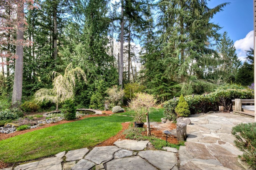 Traditional Landscape/Yard with Pond, Pathway, exterior stone floors