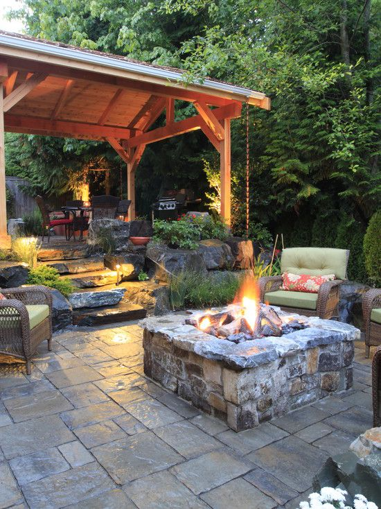 Rustic Patio with Pathway, exterior stone floors, Fire pit, Wicker arm chair, Fence, Outdoor kitchen, Gazebo