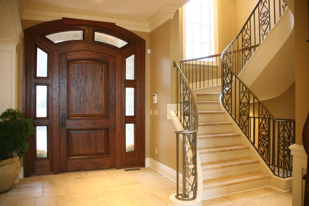 Mediterranean Entryway with Standard height, picture window, six panel door, Transom window, Concrete tile