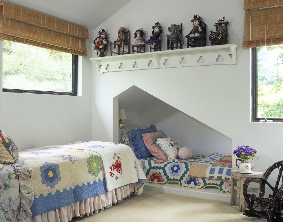 Cottage Kids Bedroom with double-hung window, Built-in bookshelf, Standard height, Carpet, no bedroom feature