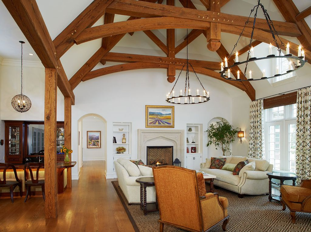 Mediterranean Living Room with Cathedral ceiling, Fireplace, Exposed beam, Currey and company simpatico orb chandelier-4l