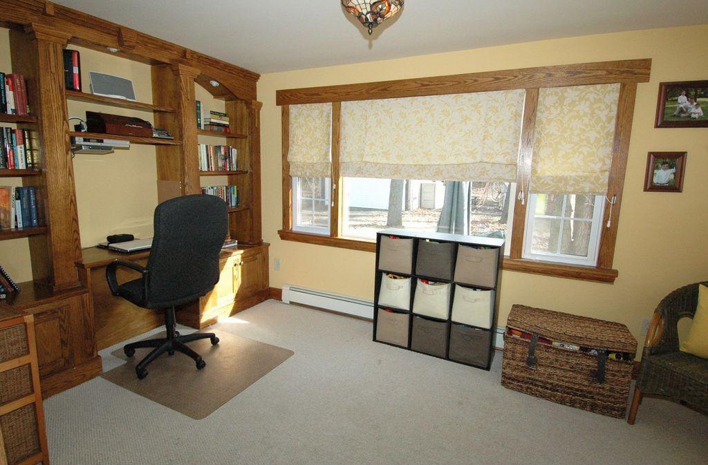 Craftsman Home Office with Casement, can lights, Standard height, Carpet, flush light, Built-in bookshelf