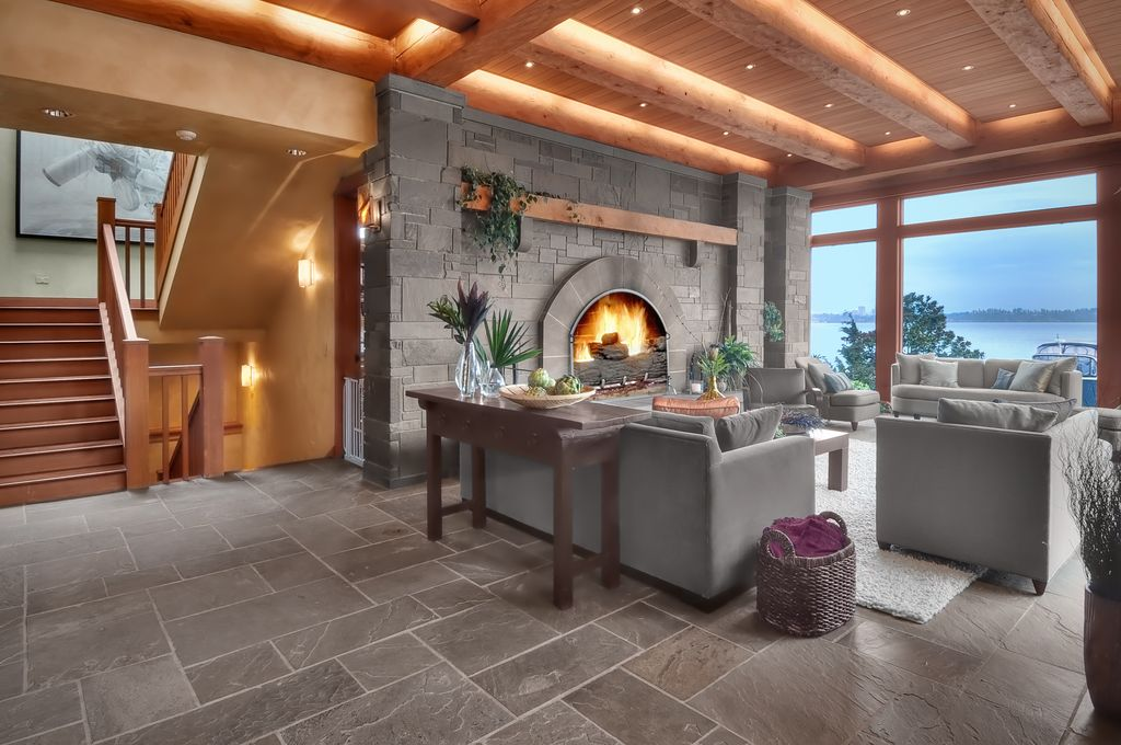 Traditional Great Room with Porcelain bullnose floor tile, stone fireplace, Paint