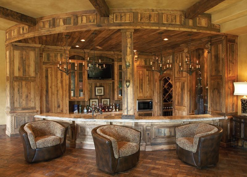 Rustic Bar with Crown molding, Columns, Exposed beam, can lights, Standard height, Chandelier, Hardwood floors