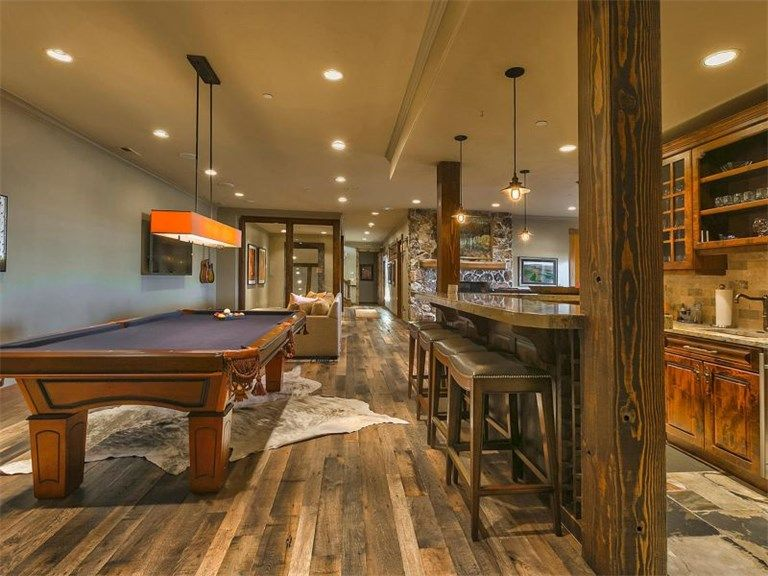 Rustic basement with columns hardwood floors zillow digs for Advanced molding and decoration s a de c v