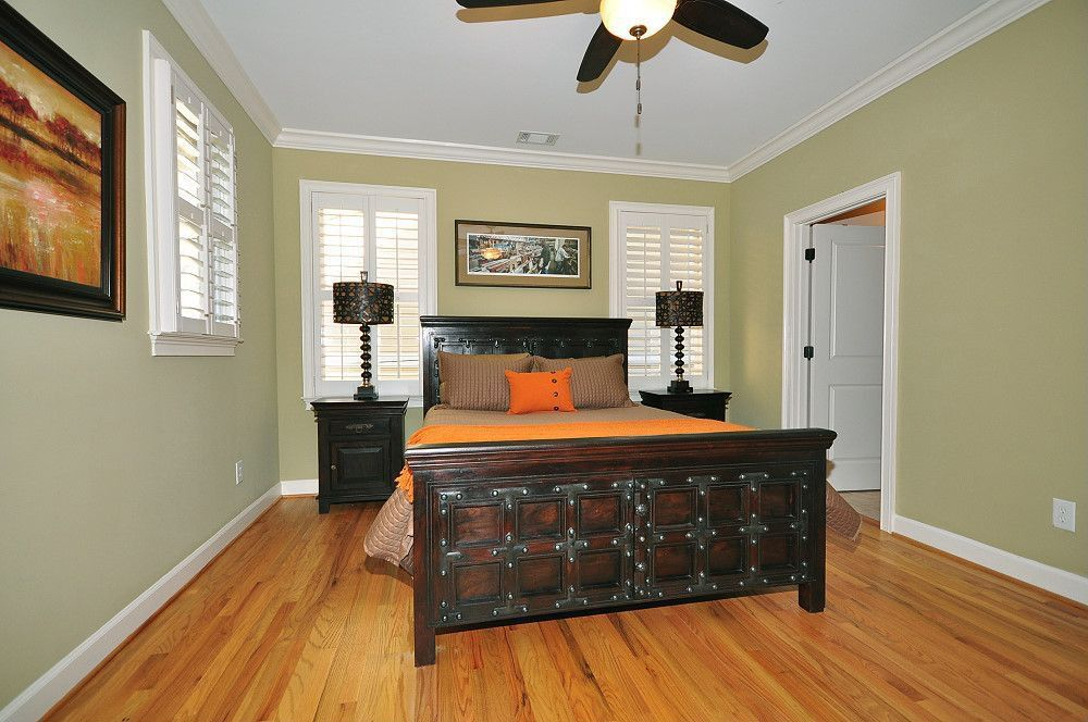 Traditional Guest Bedroom with Crown molding, specialty door, Standard height, Ceiling fan, Hardwood floors