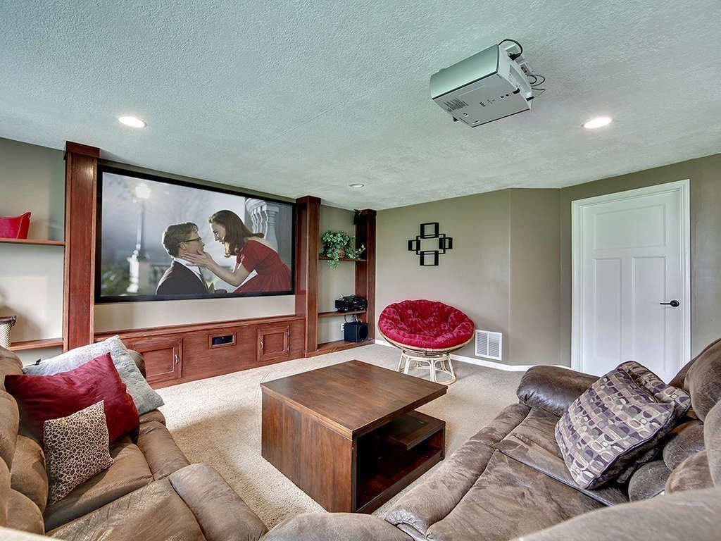 Traditional Home Theater with can lights, Built-in bookshelf, Carpet, Standard height, specialty door