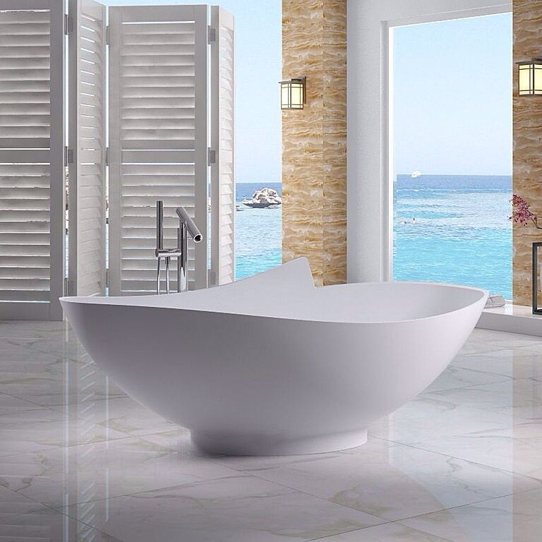 Contemporary Master Bathroom with Pental - ivory onxy, Paint 1, Mti - alissa 5 freestanding tub, simple marble floors