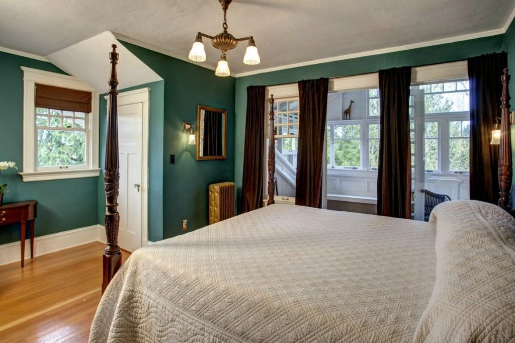 Traditional Master Bedroom with Chandelier, Wall sconce, Crown molding, specialty door, Hardwood floors