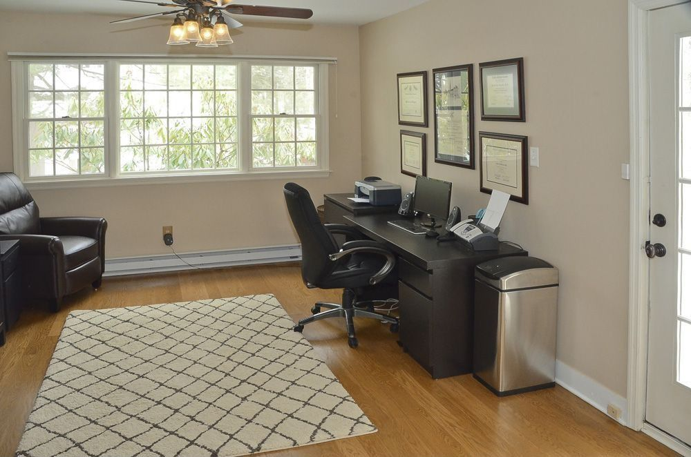 Traditional Home Office with Ceiling fan, Hardwood floors, Standard height, French doors, double-hung window