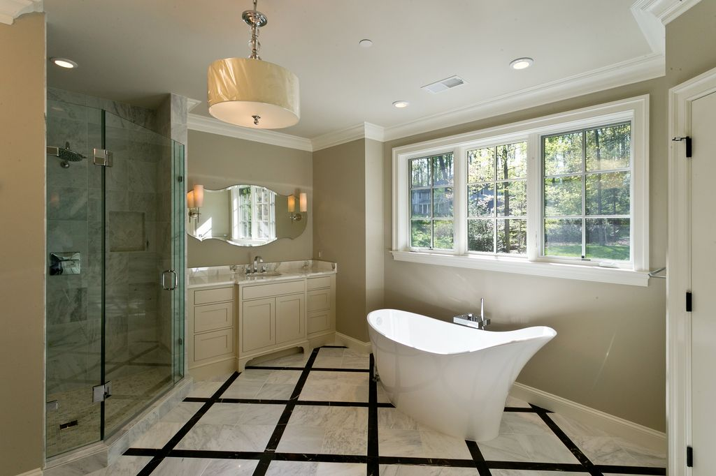 Traditional Master Bathroom with Bathtub, stone tile floors, Paint, Shower, flat door, Master bathroom, Pendant light