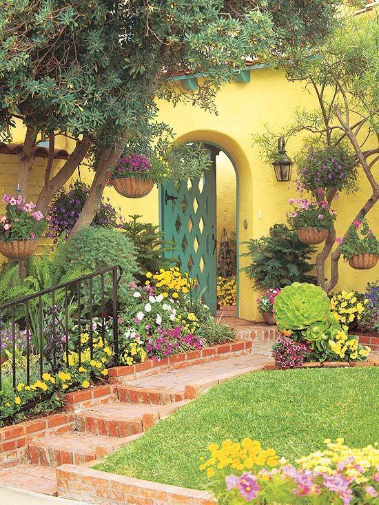 Cottage Landscape/Yard with Paint, exterior brick floors, Fence, Raised beds, Pathway, Paint 1