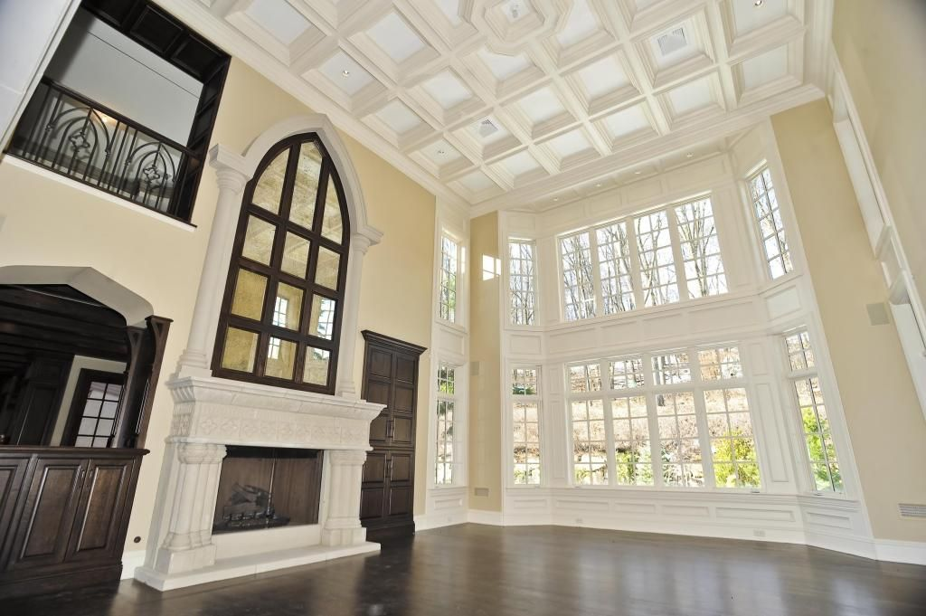 Traditional Living Room with Fireplace, Crown molding, Cathedral ceiling, specialty door, Casement, Box ceiling, can lights