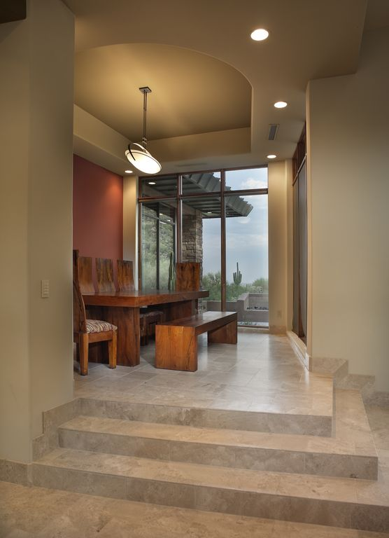 Contemporary Dining Room with can lights, flush light, Standard height, stone tile floors, picture window, slate tile floors