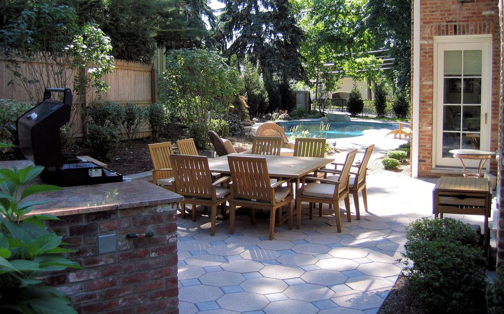 Traditional Patio with French doors, Pathway, exterior interlocking pavers, exterior tile floors, Fence, Raised beds