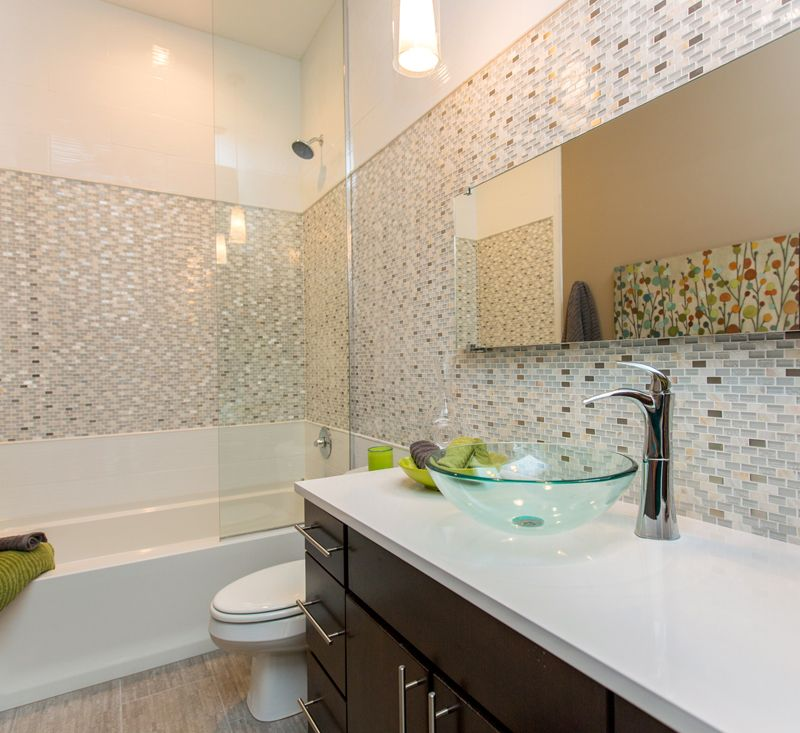 Contemporary Full Bathroom with Vessel sink, Pendant light, Wall Tiles, Ceramic Tile, Full Bath, Corian counters, Shower