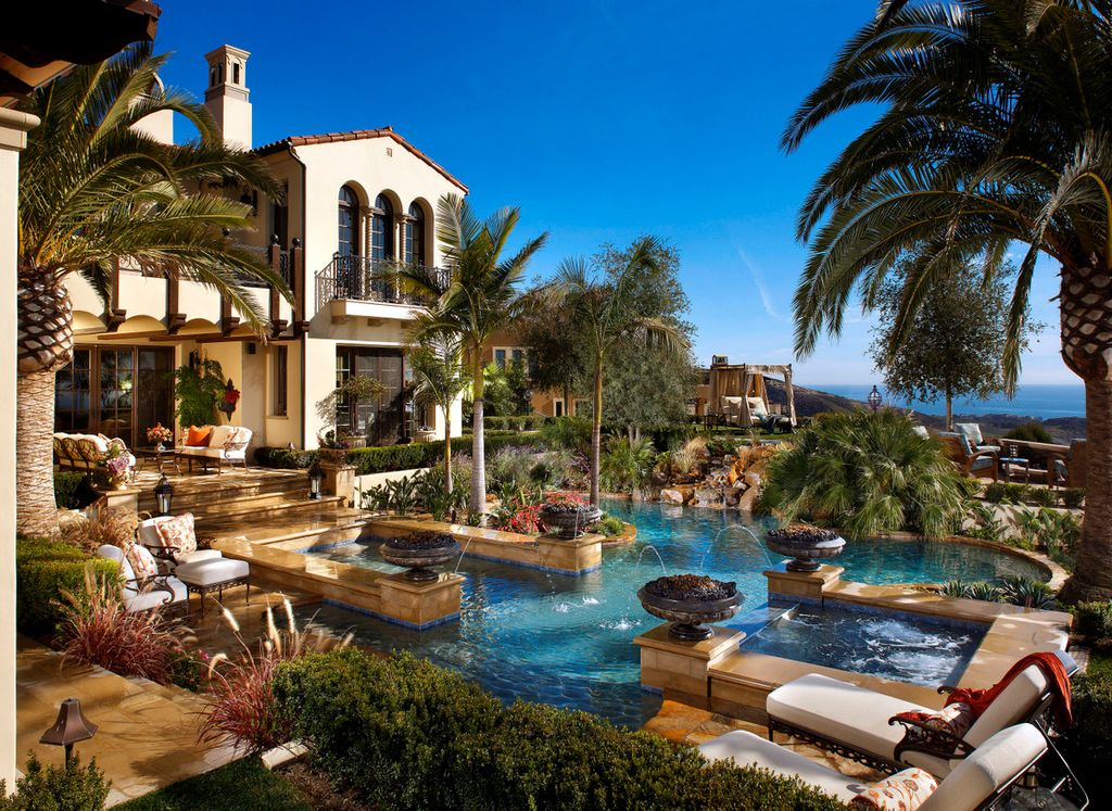 Mediterranean Swimming Pool with Deck Railing, Pool with hot tub, Fountain, French doors, Arched window